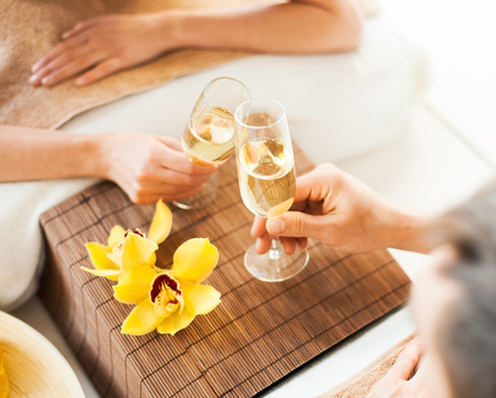 closeup of woman and man hands with champagne glasses photo