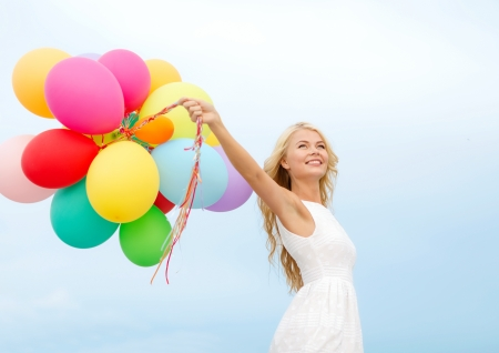 family celebration: summer holidays, celebration and lifestyle concept - beautiful woman with colorful balloons outside