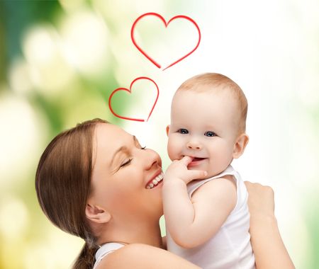 family, children, parenthood and happiness concept - happy mother with adorable baby photo