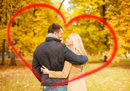 inlove: holidays, love, travel, tourism, relationship and dating concept - romantic couple kissing in the autumn park