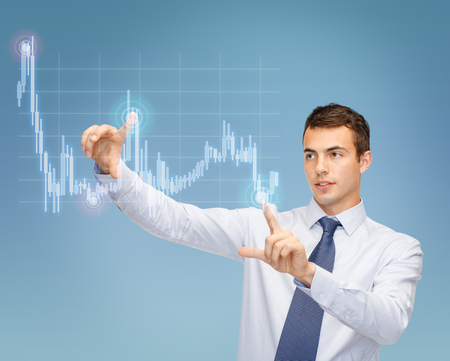 business, technology and money concept - businessman working with forex chart on virtual screen photo