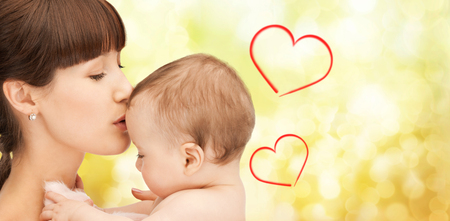 family, children, parenthood and happiness concept - happy mother with adorable baby Stock Photo - 25265887
