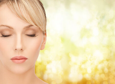 health, spa and beauty concept - beautiful woman with blonde hair photo