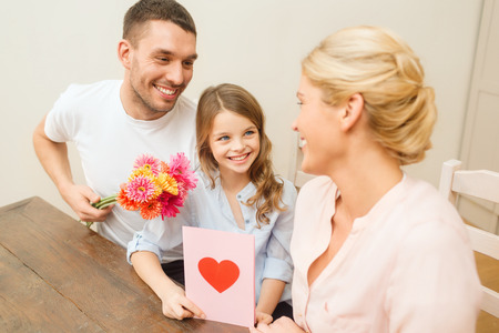 holidays, family, hapiness and people concept - happy family celebrating mothers day Stock Photo - 25266058