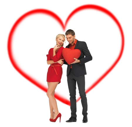 love and relationship concept - beautiful couple holding big heart photo