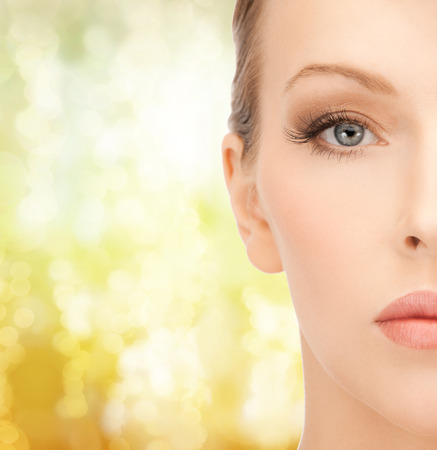 perfect face: health, spa and beauty concept - close up of face of beautiful young woman