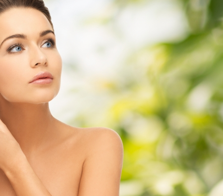 beautiful teen: beauty and health concept - beautiful woman looking up