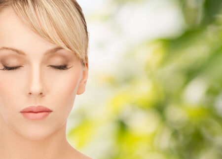 eco sensitive: health, spa and beauty concept - face of beautiful woman with blonde hair