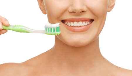 beauty and dental health concept - beautiful woman with green toothbrush Stock Photo