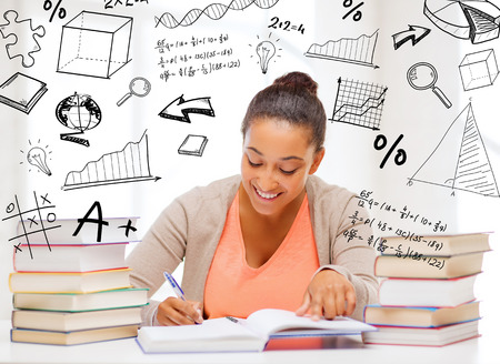 student studying: education and college concept - international student studying in college