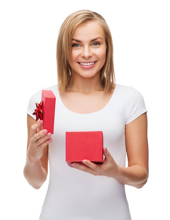 holidays, love and happiness concept - beautiful girl with gift box photo