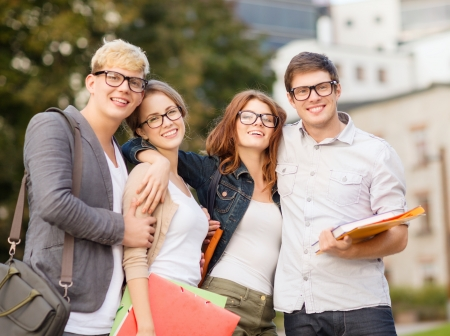 man with glasses: summer holidays, education, campus and teenage concept - group of students or teenagers with files, folders and eyeglasses hanging out Stock Photo