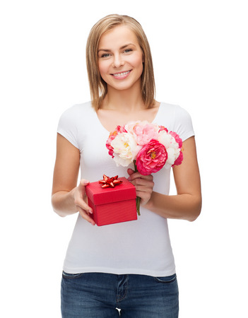 holidays, love and flowers concept - young woman with bouquet of flowers and red gift box Stock Photo - 25508287