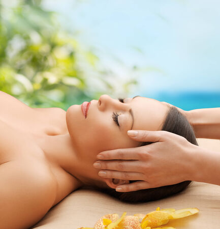 spa, resort and beauty concept - calm beautiful woman in massage salon photo