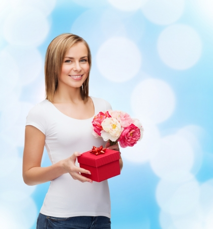 holidays, love and flowers concept - young woman with bouquet of flowers and red gift box Stock Photo - 25508538