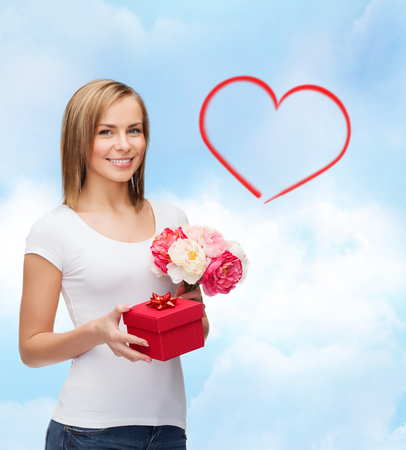 holidays, love and flowers concept - young woman with bouquet of flowers and red gift box Stock Photo - 25508539