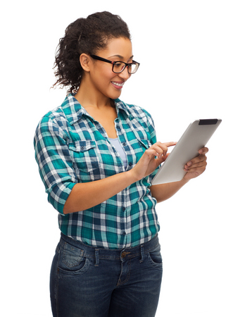 african student: education, technology and people concept - smiling female african american student in eyeglasses with tablet pc