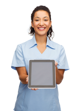 healthcare, medicine and technology concept - smiling african american female doctor or nurse with tablet pc computer photo
