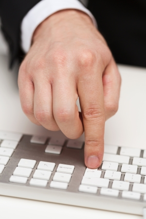 business, technology, internet and office concept - close up of businessman hands working with keyboard photo