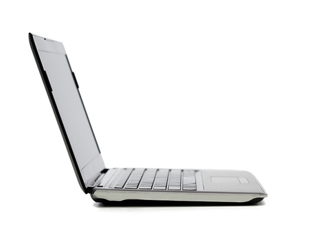 technology and advertisement concept - laptop computer with blank black screen photo