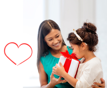 thankful: holidays, presents, christmas, x-mas, birthday concept - happy mother and child girl with gift box Stock Photo