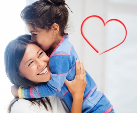 mother child: family, children and happy people concept - hugging mother and daughter Stock Photo