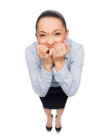 business and emotion concept - frightened and stressed businesswoman biting her fingers photo