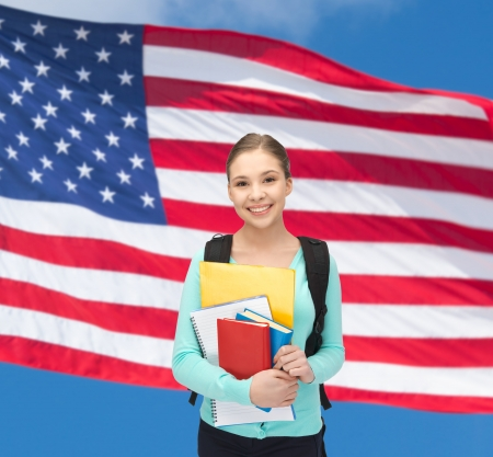 overseas visa: travel, tourism and education concept - happy and smiling teenage girl