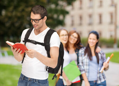 classmates: education, school and vacation concept - travelling student in eyeglasses with backpack and book Stock Photo