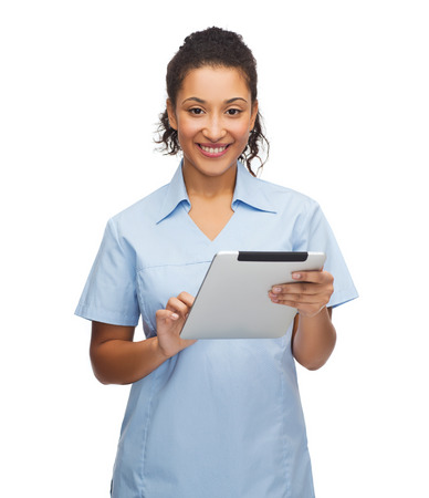 healthcare, technology and medicine concept - smiling female african american doctor or nurse with tablet pc computer photo