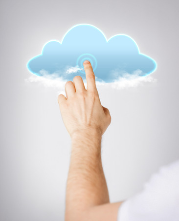 modern technology and cloud computing concept - closeup of man hand pointing at cloud photo