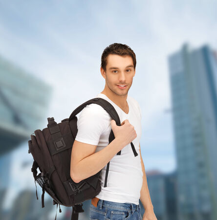 tourism, education and vacation concept - travelling student with backpack outdoor photo