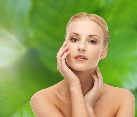portrait of beautiful woman touching her face skin