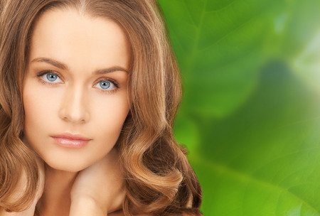health and beauty concept - face and hands of beautiful woman with long hair