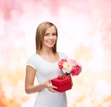 holidays, love and flowers concept - young woman with bouquet of flowers and red gift box Stock Photo - 25545497
