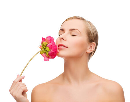 soft skin: health and beauty concept - lovely woman with pink peony flower and closed eyes