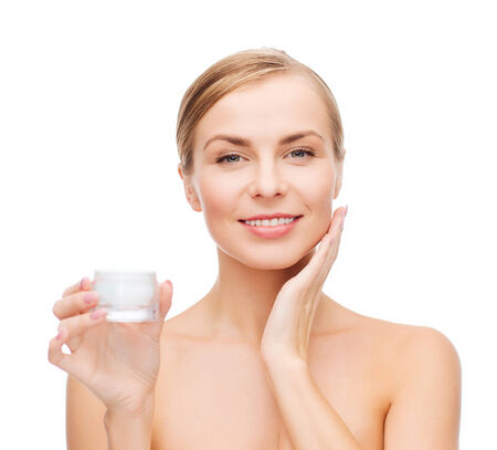 sensitive skin: cosmetics, health and beauty concept - beautiful woman applying cream on her skin