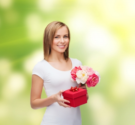holidays, love and flowers concept - young woman with bouquet of flowers and red gift box Stock Photo - 25545861
