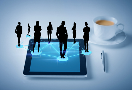 business, social and technology concept - tablet pc with cup of coffee and social or business network