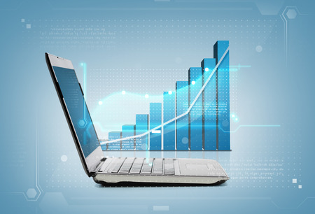 technology and economy concept - laptop computer with graph photo