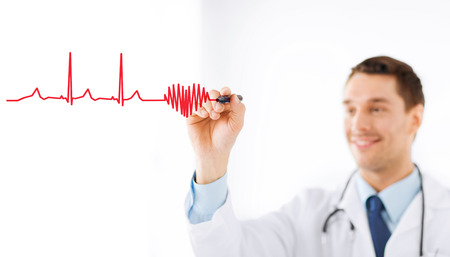 medicine, health and hospital concept - male doctor drawing heart and cardiogram in the air with marker photo