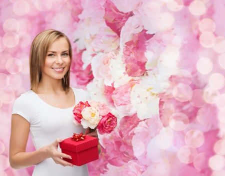 holidays, love and flowers concept - young woman with bouquet of flowers and red gift box Stock Photo - 25545928