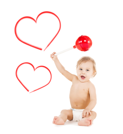 childhood and toys concept - cute little boy playing with big lollipop photo
