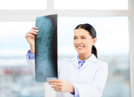 healthcare, radiology and medicine concept - smiling young doctor in cabinet photo