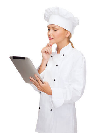 new thinking: cooking, technology and food concept - smiling female chef, cook or baker with tablet pc computer