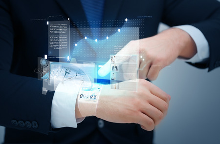 puntualidad: tiempo, los negocios y la tecnolog�a concepto nuevo - cerca de negocios que apunta a algo en su mano