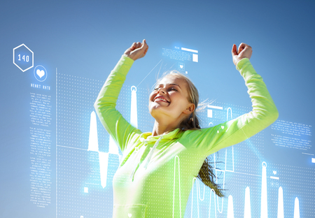 mileage: sport and lifestyle concept - woman runner celebrating victory Stock Photo