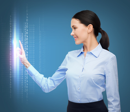 business, new technology and communication concept - businesswoman working with imaginary virtual screen photo
