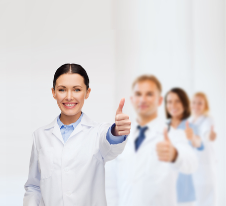 healthcare and medicine concept - smiling female doctor showing thumbs up Stock Photo - 25625919