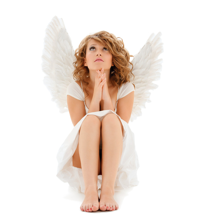 religion, faith, holidays and costumes concept - praying teenage angel girl photo